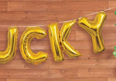 """Deko, die Glück bringt - Folienballon-Schriftzug """"Lucky"""""""